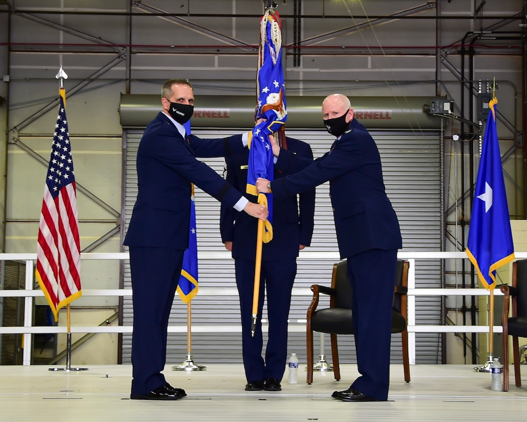 Brig. Gen. Jeffrey T. Pennington, 4th Air Force commander at March Air Reserve Base, California, passes the guidon to Col. Thomas O. Pemberton, 434th Air Refueling Wing commander, during an assumption of command ceremony at Grissom Air Reserve Base, Ind. April 10, 2021. Pemberton was previously the 514th Air Mobility Wing commander at Joint Base McGuire-Dix-Lakehurst, New Jersey. (U.S. Air Force photo by Staff Sgt. Chris Massey)