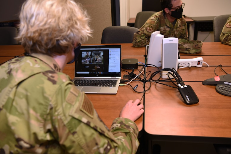 U.S. Air Force Chief Master Sgt. Breana Oliver, 17th Training Group superintendent, prepares a video chat for Maj. Gen. Leah Lauderback, director of Intelligence, Surveillance and Reconnaissance, U.S. Space Force and U.S. Space Force Chief Master Sgt. Roger Towberman, Chief Master Sergeant of the Space Force to talk with Guardians stationed at Goodfellow Air Force Base, Texas, April 5, 2021. Guardians stationed at Goodfellow were able to ask service specific questions and learn more about the Space Force and what the future holds for the newest branch of the armed forces. (U.S. Air Force photo by Senior Airman Abbey Rieves)