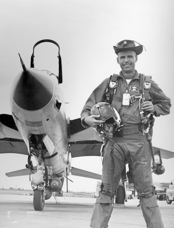 Col. Krone wearing the hat on display. Attached to the hat is a Royal Thai Air Force pilot's badge. (U.S. Air Force photo)