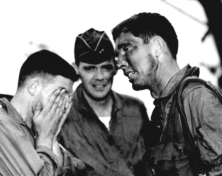 Rescued pilot (right) with fellow USAF pilots who helped bring him out of North Vietnam. (U.S. Air Force photo)
