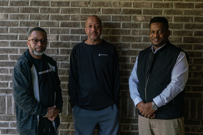 Carlos Brown, left, a pastor and the business representative for the International Longshoreman's Association, Mark Brown, middle, a retired Marine, and Jason Brown, the Fine Arts Department Chair and Band Director for East St. Louis High School, pose for a photo in Swansea, Ill., Feb 27, 2021. The three men were gathered together for an interview about their life story. (U.S. Marine Corps photo by Sgt. Andrew Jones)