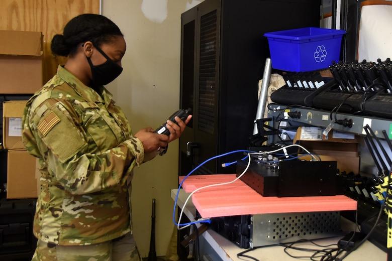 U.S. Air Force Staff Sgt. Tiffany Greene, 145th Communications Flight, tests a hand-held radio at the North Carolina Air National Guard Base, Charlotte Douglas International Airport, April 11, 2021. Greene was in communications for six years in the U.S. Army National Guard before joining the Air National Guard in 2021.
