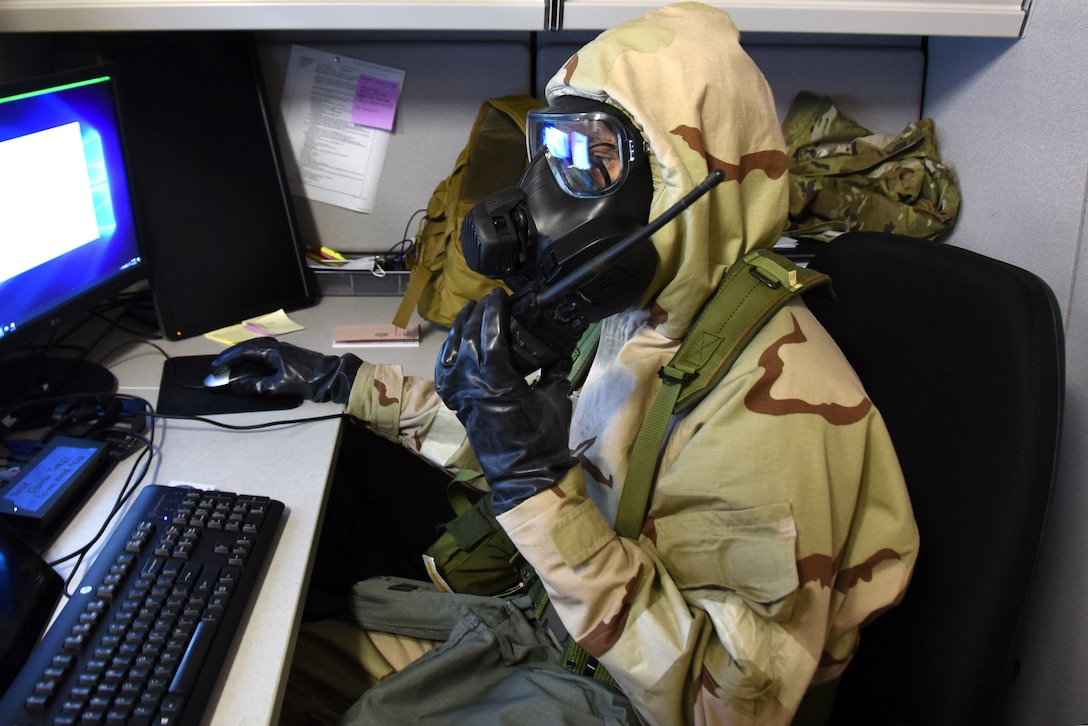 U.S. Air Force Staff Sgt. Rashad Rizer, 145th Communications Flight client system technician, responds to an Emergency Operations Center accountability request during practice for a large-scale readiness exercise at the North Carolina Air National Guard Base.