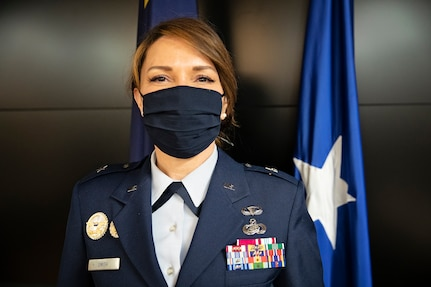 Brig. Gen. Tracy D. Smith, assistant adjutant general-air and commander of the Alaska Air National Guard, poses for a photo after she was promoted to the rank of brigadier general at a ceremony on Joint Base Elmendorf-Richardson, Alaska, April 1, 2021. Smith took command of the Alaska Air National Guard in January. (U.S. Army National Guard photo by Edward Eagerton)