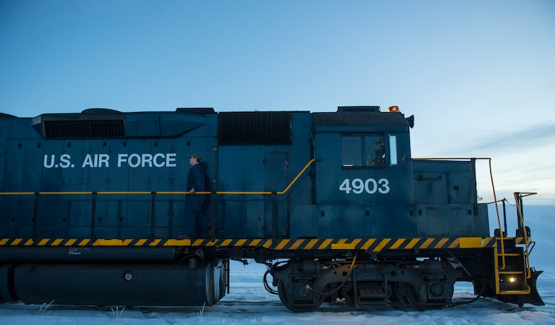 An Air Force locomotive prepares to transport coal to the central heat and power plant at Eielson Air Force Base, Alaska. The locomotive transports 800 tons of coal during the winter months and is the sole source of heat and power for the entire base. (U.S. Air Force photo by/Staff Sgt. Vernon Young Jr.)