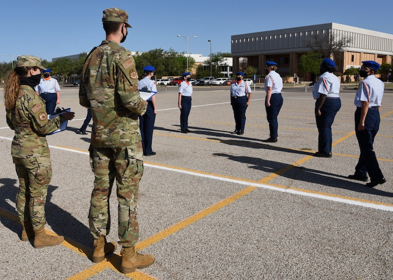 U.S. Air Force students from the 315th Training Squadron voluntarily judge a performance at the Air Force ROTC Detachment 847's Annual Drill Meet, at Angelo State University in San Angelo, Texas, April 10, 2021. Five high schools from across Texas participated in the competition and networked with Team Goodfellow following the events. (U.S. Air Force photo by Senior Airman Abbey Rieves)