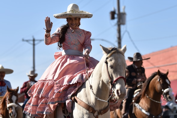 A Charros De Rancho Cabrera rider waves during the 89th Annual San Angelo Rodeo parade through downtown San Angelo, Texas, April 10, 2021. The entries rode or drove through downtown while individuals could watch from the sidelines. (U.S. Air Force photo by Staff Sgt. Seraiah Wolf)