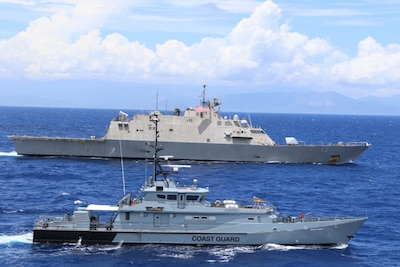 CARIBBEAN SEA – (April 9, 2021) -- The Freedom-variant littoral combat ship USS Wichita (LCS 13) and Jamaica Defence Force Coast Guard patrol vessel HMJS Cornwall sail in formation during a live-fire exercise April 9, 2021. Wichita is deployed to the U.S. 4th Fleet of operations to support Joint Interagency Task Force South's mission, which include counter illicit drug trafficking in the Caribbean and Eastern Pacific