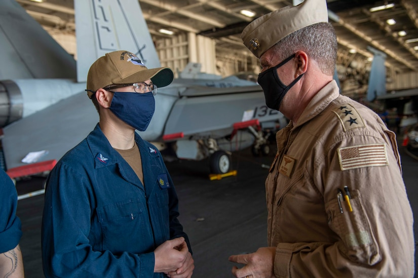 210411-N-AY174-1086 DUQM (April 11, 2021) - Vice Adm. Samuel Paparo, commander of U.S. Naval Forces Central Command (NAVCENT), U.S. 5th Fleet and Combined Maritime Forces speaks with Sailors aboard aircraft carrier USS Dwight D. Eisenhower (CVN 69) during a sustainment and logistics visit in Duqm, Oman, April 11. The Eisenhower Carrier Strike Group is deployed to the U.S. 5th Fleet area of operations in support of naval operations to ensure maritime stability and security in the Central Region, connecting the Mediterranean and Pacific through the western Indian Ocean and three strategic choke points. (U.S. Navy photo by Mass Communication Specialist 3rd Class Brianna T. Thompson-Lee)