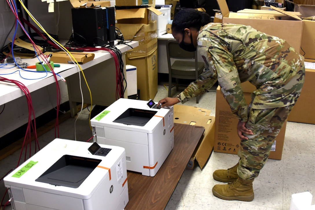 U.S. Air Force Staff Sgt. Tiffany Greene, 145th Communications Flight, obtains an IP address and re-images a printer at the North Carolina Air National Guard Base, Charlotte Douglas International Airport, April 11, 2021