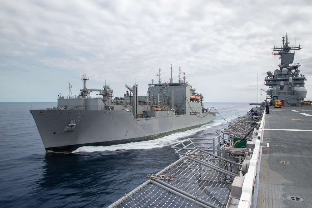The  Lewis and Clark-class dry cargo and ammunition ship USNS Robert E. Peary (T-AKE 5) sails alongside the Wasp-class amphibious assault ship USS Kearsarge (LHD 3) during a replenishment-at-sea.