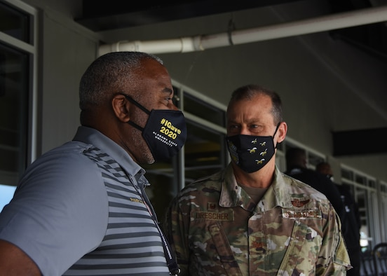 Alabama State University president, Dr. Quinton Ross and 908th Airlift Wing commander, Col. Craig Drescher discuss the ongoing partnership between the university and the wing before the 908th conducted a flyover prior to the start of an ASU home football game April 10 at ASU stadium in Montgomery, Alabama.