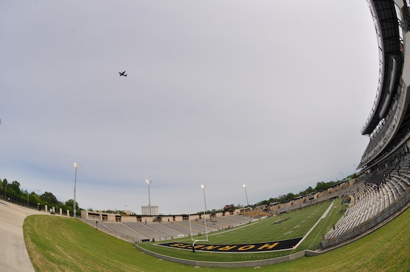 C-130 flying over a stadium