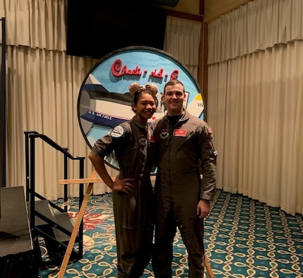 U.S. Air Force 1st Lt. Alicia and 1st Lt. Jordan Paecth, 75th Expeditionary Airlift Squadron safety officers, pose for a photo in their flight suits during pilot training at Laughlin Air Force Base, Texas. Safety representatives help ensure agencies within the Air Force maintain the proper safety techniques in the workplace to ensure mission success.
