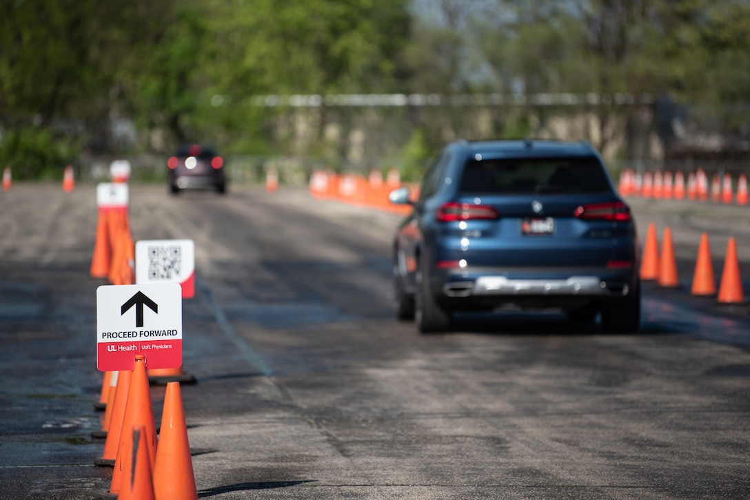 Cars navigate a labyrinth of traffic cones of their way to Kentucky's largest drive-through COVID-19 vaccination clinic at Cardinal Stadium in Louisville, Ky., April 12, 2021. The clinic, which will be open seven weeks, can vaccinate up to 4,000 patients a day. (U.S. Air National Guard photo by Dale Greer)