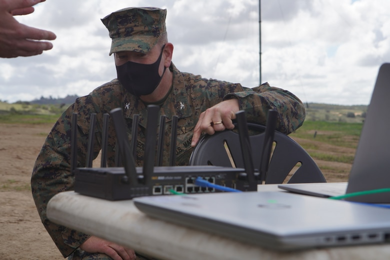 U.S. Marine Corps Col. Brian Rideout, inspects the routing system for the Cloud Layered Obfuscation Application Kit during a practical exercise at Marine Corps Base Camp Pendleton, California, March 9.