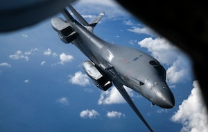 A U.S. Air Force B-1B Lancer aircraft assigned to the 7th Bomb Wing departs from a KC-135 Stratotanker aircraft assigned to the 100th Air Refueling Wing after receiving fuel during a Bomber Task Force mission off the Scottish Coast, April 12, 2021. U.S. bomber aircraft contribute to European regional security with the support of U.S. Air Forces in Europe and Air Forces Africa's only permanent air refueling wing. (U.S. Air Force photo by Tech. Sgt. Emerson Nuñez)
