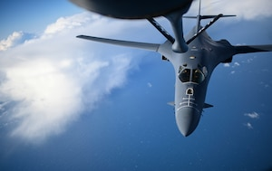 A U.S. Air Force B-1B Lancer aircraft assigned to the 7th Bomb Wing approaches a KC-135 Stratotanker aircraft assigned to the 100th Air Refueling Wing to receive fuel during a Bomber Task Force mission off the Scottish Coast, April 12, 2021. The U.S. routinely and visibly demonstrates commitment to allies and partners through the global employment of its military forces. (U.S. Air Force photo by Tech. Sgt. Emerson Nuñez)