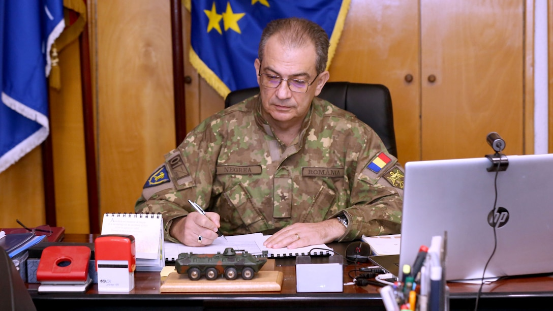 A military general signs a document