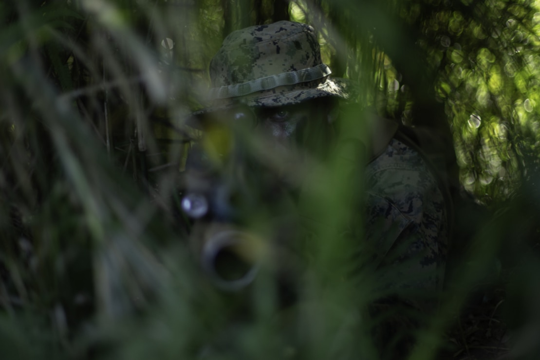 U.S. Marine Corps Cpl. Tyler Rautheaux, provides security during urban operations within the Central Training Area on Okinawa, Japan, April 7.