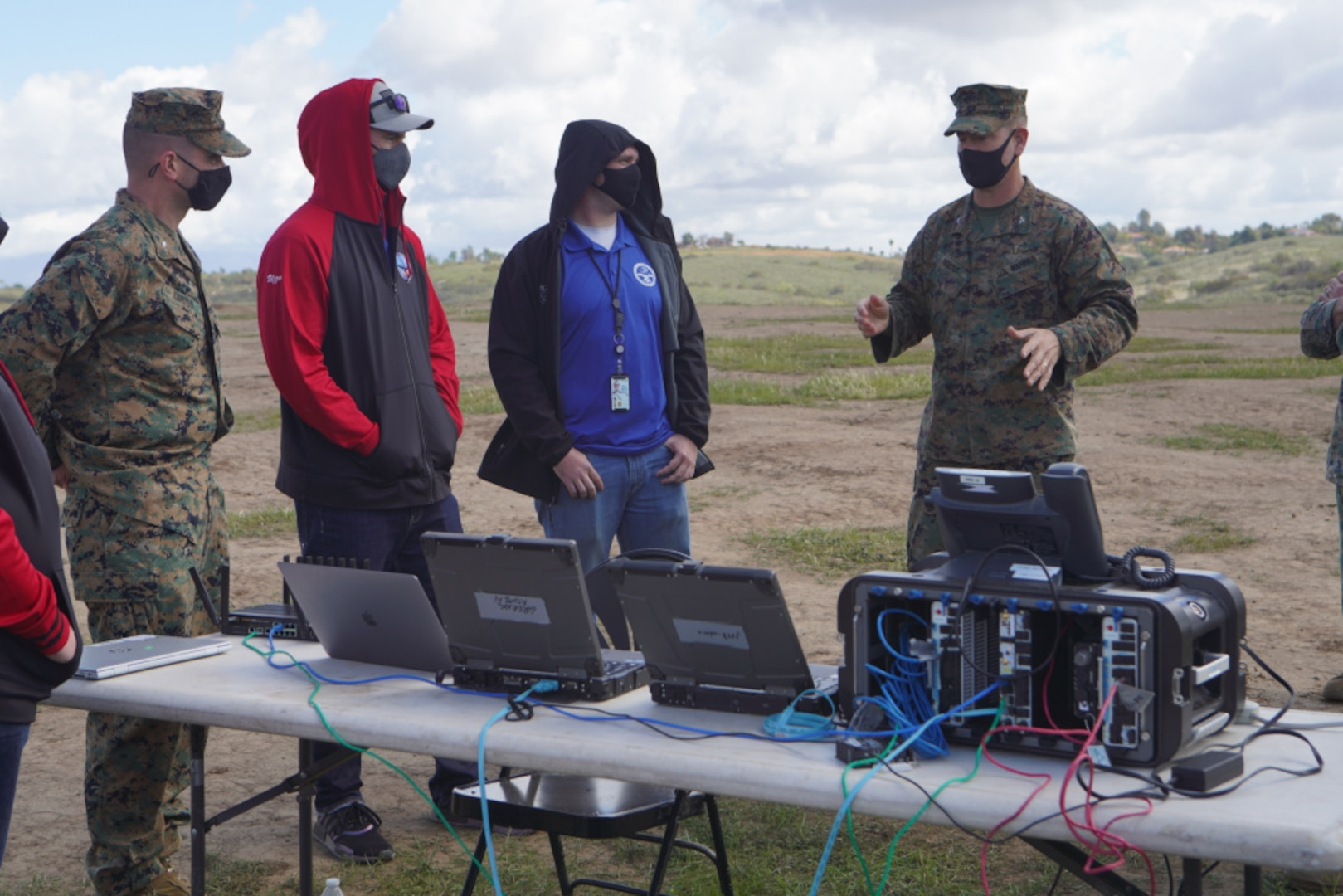 U.S. Marine Corps Col. Brian Rideout (right), discusses the vision for the Cloud Layered Obfuscation Application Kit during a practical exercise at Marine Corps Base Camp Pendleton, California, March 9.