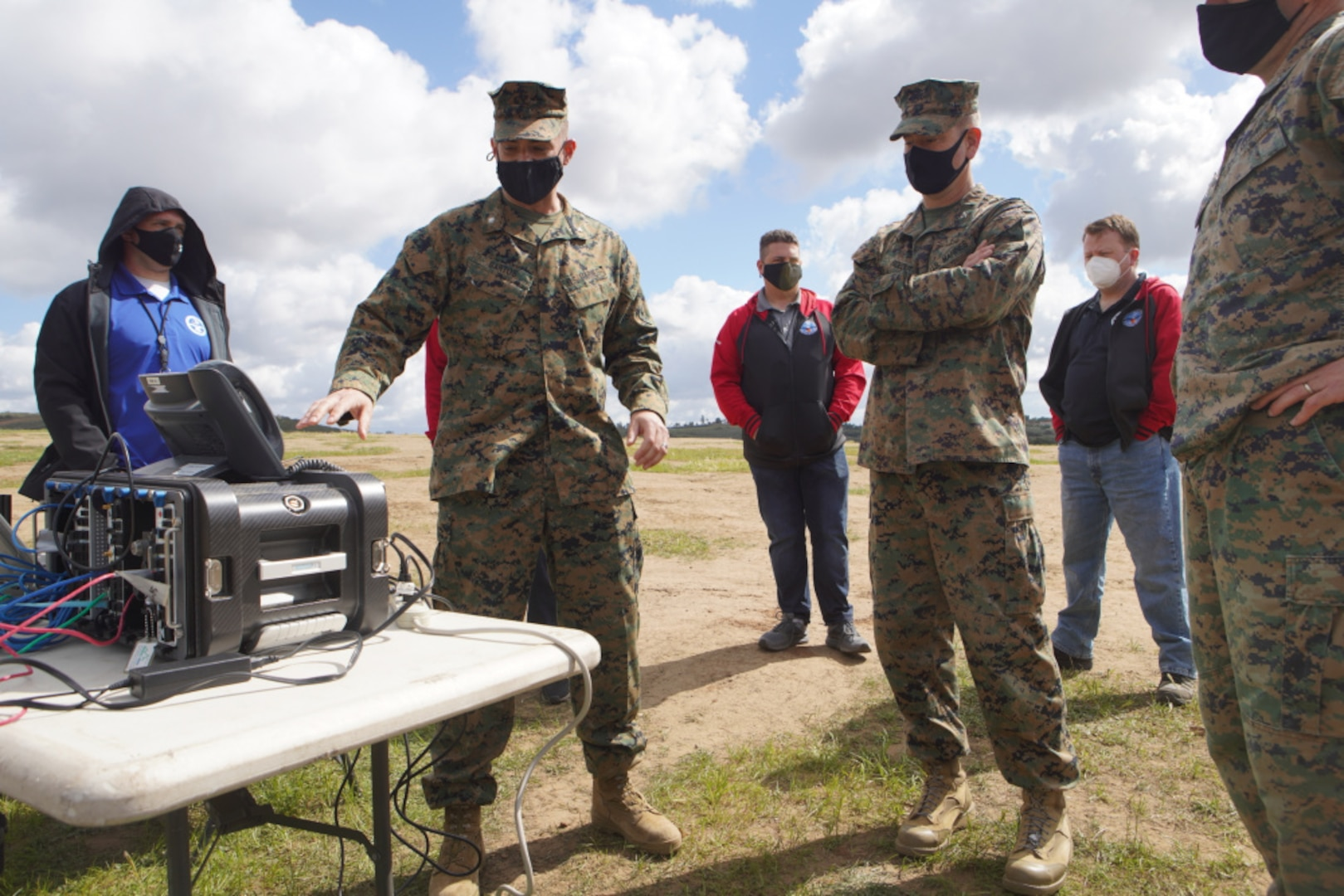U.S. Marine Corps Lt. Col. Daniel Bartos (left) with Defense Information Systems Agency explains the concept of the Cloud Layered Obfuscation Application Kit to Col. Brian Rideout, commanding officer for I Marine Expeditionary Force Information Group, during a practical exercise at Marine Corps Base Camp Pendleton, California, March 9.