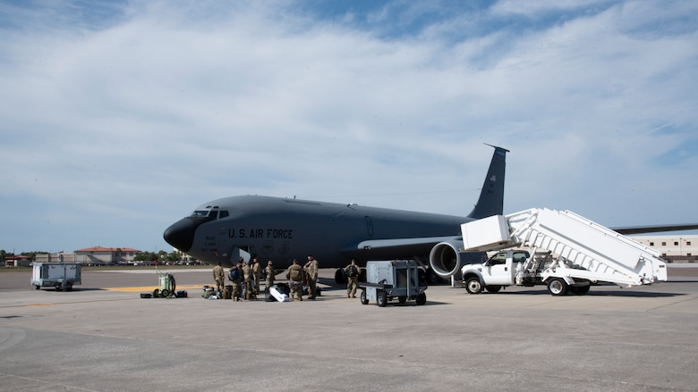 Team MacDill Airmen stand outside a KC-135 Stratotanker aircraft on the flight line, April 8, 2021 at MacDill Air Force Base, Fla.