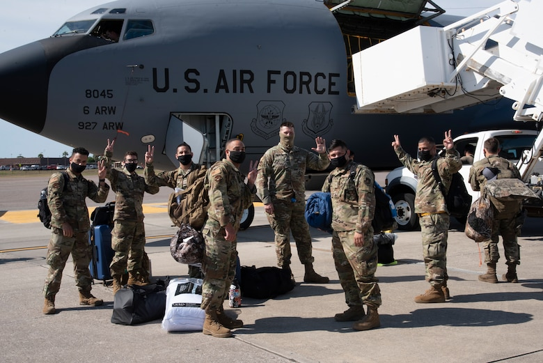 Team MacDill Airmen pose for a photo outside a KC-135 Stratotanker aircraft on the flight line, April 8, 2021 at MacDill Air Force Base, Fla.