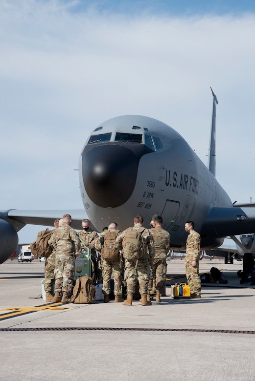 Team MacDill Airmen gather outside a KC-135 Stratotanker aircraft on the flight line, April 8, 2021 at MacDill Air Force Base, Fla.