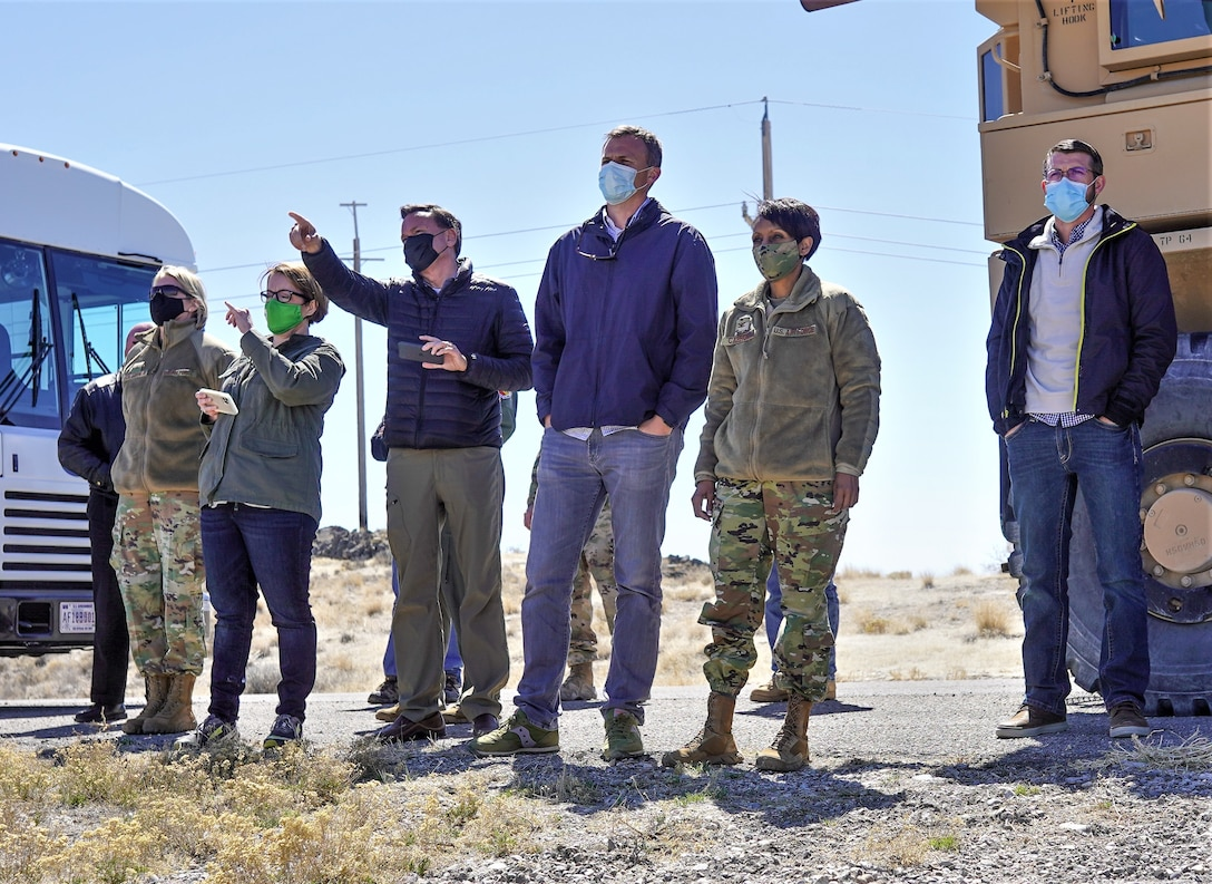 U.S. Rep. Blake Moore (UT-1), congressional staff, and base leadership standing while they observe a controlled detonation.