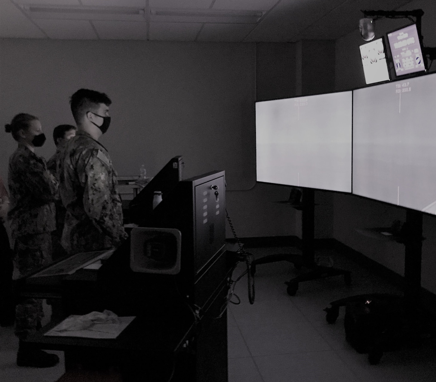 NEWPORT, R.I. (March 23, 2021) Students in the pilot convening of the Officer of the Deck Phase II course conduct a practical scenario in a Ship Simulator at Surface Warfare Schools Command.  OOD-II will be introduced to the fleet concentration areas in October 2021, and will be taught at SWSC's Mariner Skills Training Command Pacific (MSTCPAC) in San Diego, California, and Mariner Skills Training Command Atlantic (MSTCLANT) in Norfolk, Virginia. (U.S. Navy photo by Lt. Cmdr. Shawn Tagan)
