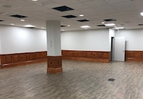 IMAGE: Building 1490's first floor conference room now includes an AV and storage area. Before the demolition and new construction, two conference rooms populated the area; now, the area houses one large conference room with the storage area.