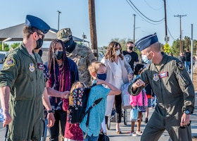 Brig. Gen. Matthew Higer, 412th Test Wing Commander, greets students and their family during the first day of physical in-person learning and grand reopening of Bailey Elementary School on Edwards Air Force Base, California, April 12. (Air Force photo by Giancarlo Casem)