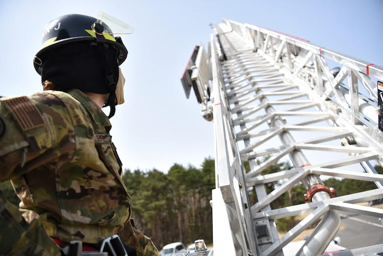 U.S. Air Force Staff Sgt. Journey Collier, a 35th Civil Engineer Squadron firefighter, raises a fire truck ladder at Misawa Air Base, Japan, March 31, 2021. Collier won the Air Force Military Firefighter of the Year award. This annual award recognizes a military firefighter for superior job performance and outstanding contributions to a Department of Defense and fire and emergency services organization. (U.S. Air Force photo by Airman 1st Class Joao Marcus Costa)