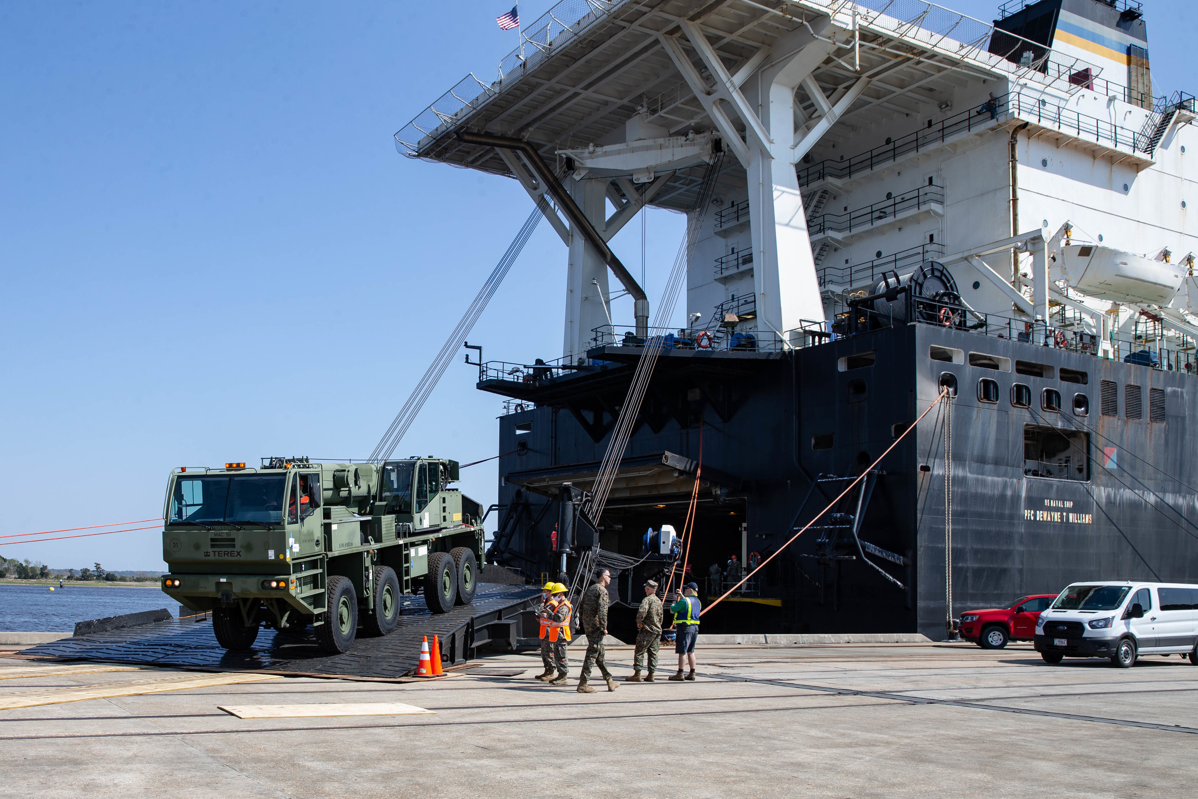 U.S. Marines offload a logistic vehicle system replacement (LVSR) from the well deck of the 2nd Lt John P. Bobo-class dry cargo ship USNS PFC Dewayne T. Williams (T-AK-3009)