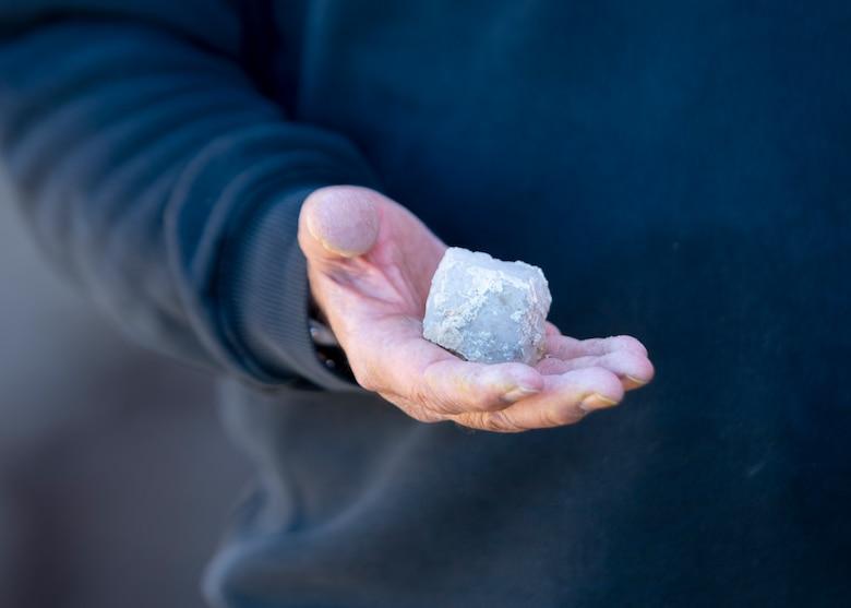 Tribal representative holds a piece of quartz.