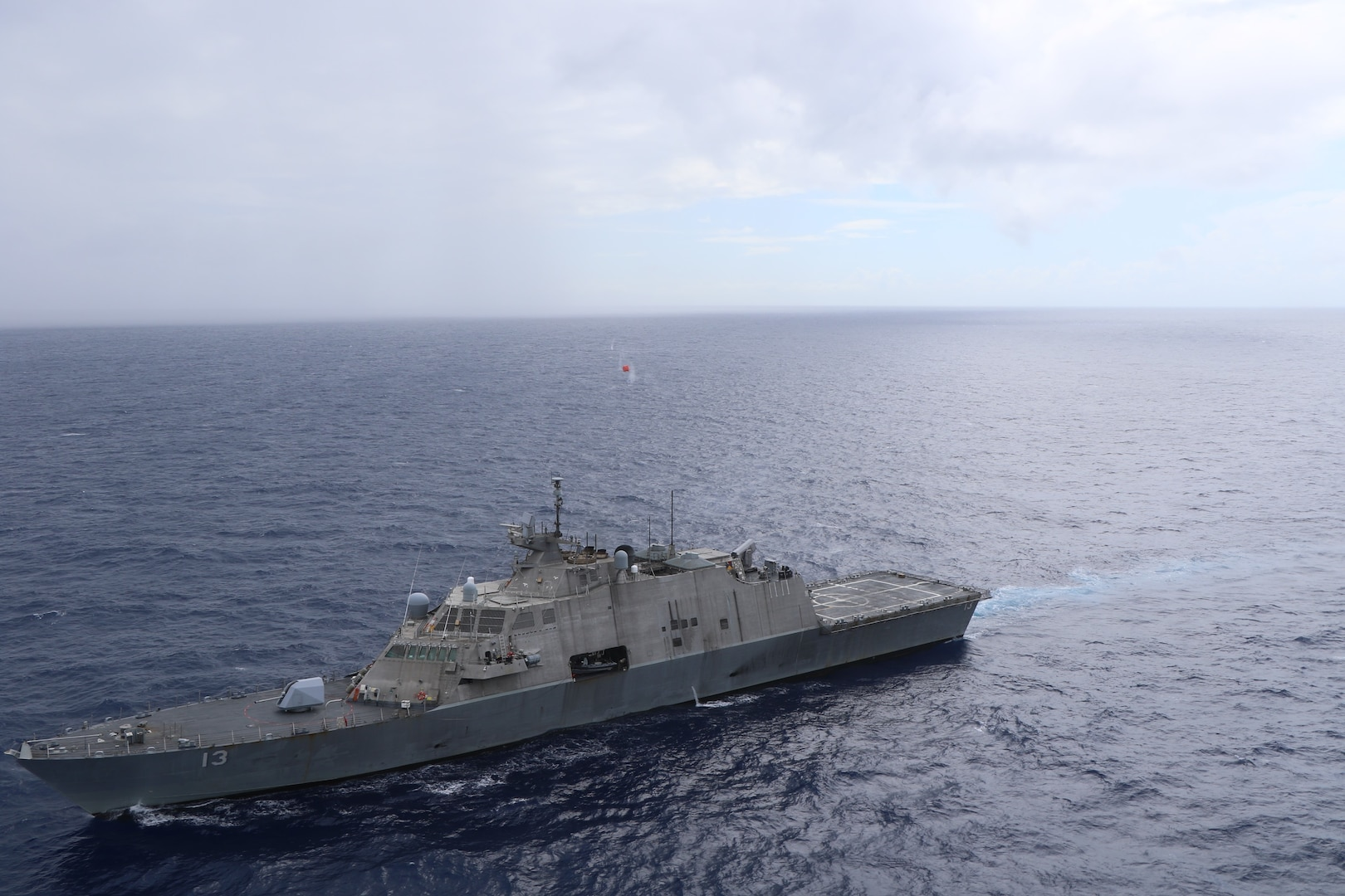 USS Wichita (LCS 13) fires at the floating training target during the bi-lateral live fire exercise with the Jamaica Defense Force Coast Guard patrol vessel HMJS Cornwall, April 9, 202