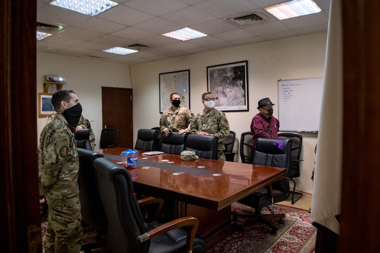 a group of airmen attend a meeting