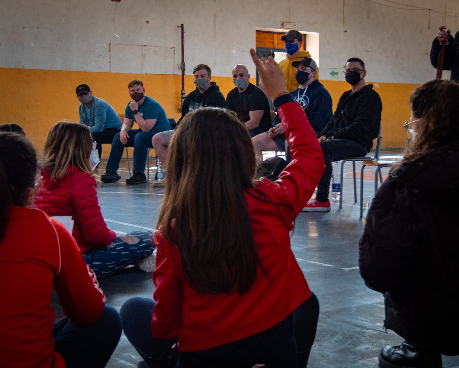 """210304-N-VH871-1536 SIGONELLA, Italy (March 4, 2021) Sailors assigned to the """"Grey Knights"""" of Patrol Squadron (VP) 46, assist Italian middle schoolers with their English proficiency as part of a community relations project, March 4, 2021. VP-46 is currently forward-deployed to the U.S. Sixth Fleet area of operations and is assigned to Commander, Task Force 67, responsible for tactical control of deployed maritime patrol and reconnaissance squadrons throughout Europe and Africa. U.S. Sixth Fleet, headquartered in Naples, Italy, conducts a full spectrum of joint and naval operations, often in concert with allied and interagency partners, in order to advance U.S. national security interests and stability in Europe and Africa. (U.S. Navy photo by Mass Communication Specialist 2nd Class Austin Ingram/ Released)"""