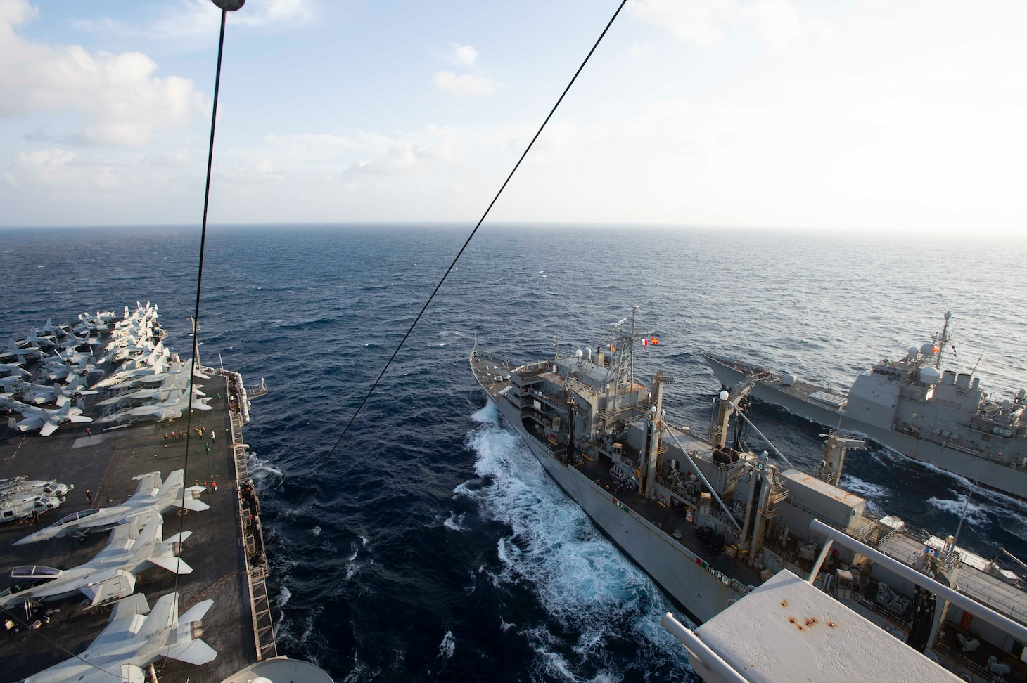 210307-N-YD547-2029 ATLANTIC OCEAN (March 7, 2021) The Nimitz-class aircraft carrier USS Dwight D. Eisenhower (CVN 69), left, conducts a replenishment-at-sea with the fast-combat support ship USNS Arctic (T-AOE 8), center, and the Ticonderoga-class guided-missile cruiser USS Monterey (CG 61), in the Atlantic Ocean, March 7, 2021. The IKE Carrier Strike Group is on a scheduled deployment in the U.S. Sixth Fleet area of operations in support of U.S. national interests and security in Europe and Africa. (U.S. Navy photo by Mass Communication Specialist Seaman Trent P. Hawkins/Released)