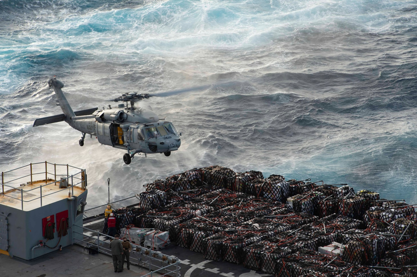 "210307-N-YD547-2074 ATLANTIC OCEAN (March 7, 2021) An MH-60S Sea Hawk, attached to the ""Dusty Dogs"" of Helicopter Sea Combat Squadron (HSC) 7, transports supplies from the fast-combat support ship USNS Arctic (T-AOE 8) to the Nimitz-class aircraft carrier USS Dwight D. Eisenhower (CVN 69), during a vertical-replenishment in the Atlantic Ocean, March 7, 2021. The IKE Carrier Strike Group is on a scheduled deployment in the U.S. Sixth Fleet area of operations in support of U.S. national interests and security in Europe and Africa. (U.S. Navy photo by Mass Communication Specialist Seaman Trent P. Hawkins/Released)"