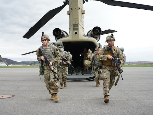 Soldiers from Bravo Company, 1st Battalion, 109th Infantry Regiment, 2nd Infantry Brigade Combat Team, practice deploying from a CH-47 Chinook during aerial movement training on April 9, 2021. The Soldiers from 1-109th were supported by crews and pilots from the 28th Expeditionary Combat Aviation Brigade (U.S. Army Photo by Sgt. 1st Class Matthew Keeler)