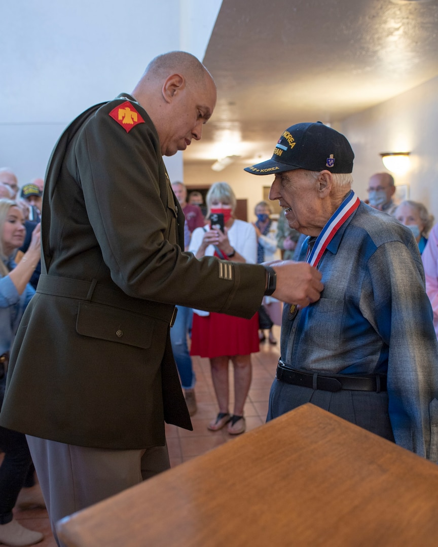 Maj. Gen. Michael Thompson, adjutant general for Oklahoma, presents the Thunderbird Medal to Lt. Col. (Ret.) Oren L. Peters, World War II and Korean War Veteran from the renowned 45th Infantry Division, Saturday, April 10, 2021 in Edmond, Oklahoma. The Thunderbird Medal is the Oklahoma National Guard's highest award presented to a civilian. (Oklahoma National Guard photo by Lt. Col. Geoff Legler)