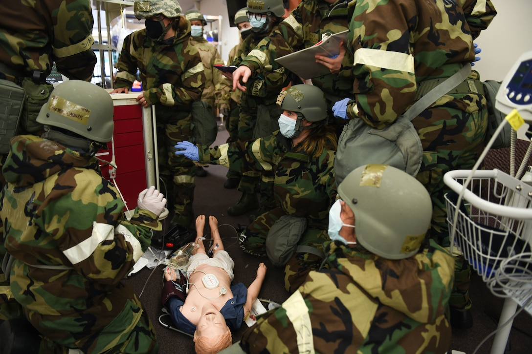 U.S. Airmen from the 31st Fighter Wing perform a code blue drill on a mannequin during an exercise at Aviano Air Base, Italy, April 12, 2021. Cardiac or respiratory arrest drills, known as code blue, are performed on mannequins to ensure proper readiness in the event of real-world, medical emergencies. (U.S. Air Force photo by Senior Airman Ericka A. Woolever)