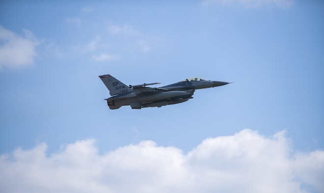 An F-16 Fighting Falcon assigned to the 52nd Fighter Wing takes off from the runway as part of exercise Point Blank 21-02 at Spangdahlem Air Base, Germany, April 9, 2021. Aircraft from Spangdahlem took part in a multi-day exercise over the North Sea for a high-end combat simulation environment with NATO partners. (U.S. Air Force photo by Senior Airman Ali Stewart)