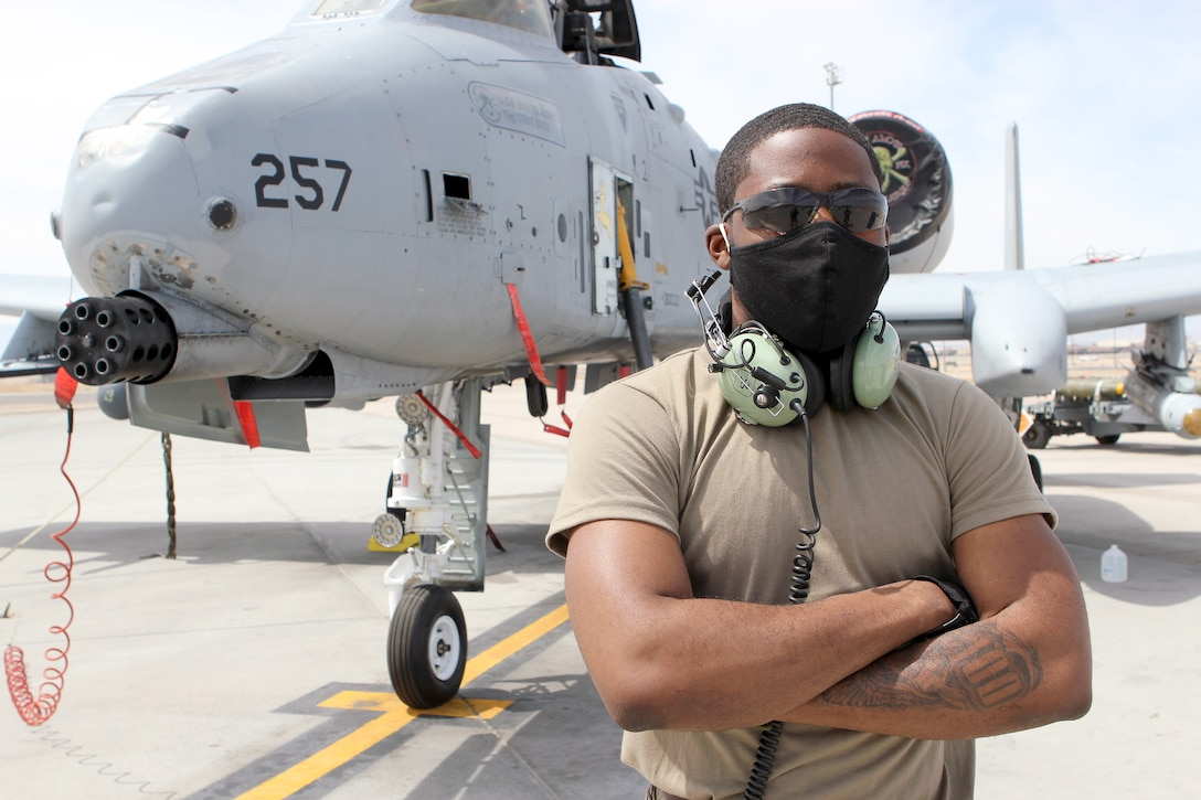 Senior Airman Maurice Starks stand in front of an A-10 Thunderbolt II aircraft while at Nellis Air Force Base, Nev., April 9, 2021. Starks is a weapons loader on the A-10 in the Michigan Air National Guard. He is also a full-time college student and is enrolled in an Air Force ROTC program. (U.S. Air National Guard photo by Master Sgt. Dan Heaton)
