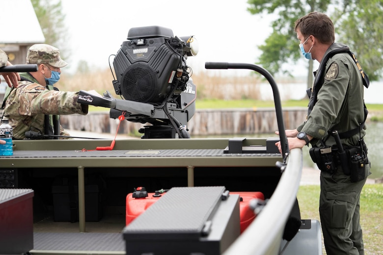 Members of the Louisiana National Guard, participating in the annual disaster response exercise, receive instruction during a boater education course in partnership with the Louisiana Department of Wildlife and Fisheries at Spanish Lake in New Iberia, Louisiana, April 7, 2021.
