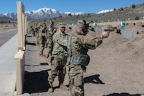 Soldiers shooting pistols at pistol range.