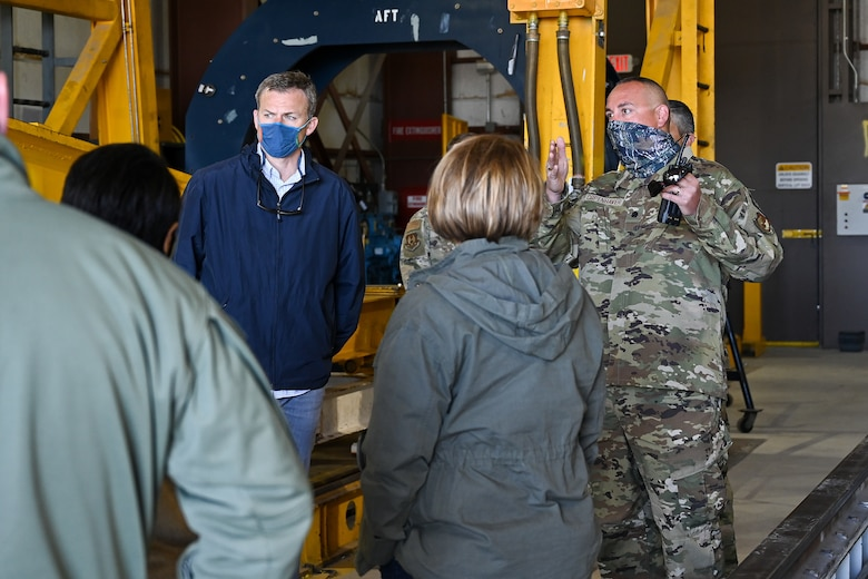 U.S. Rep. Blake Moore (UT-1) and other standing in a missile transfer facility.