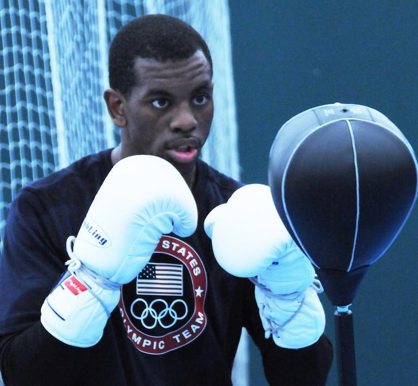 A boxer takes a stance.